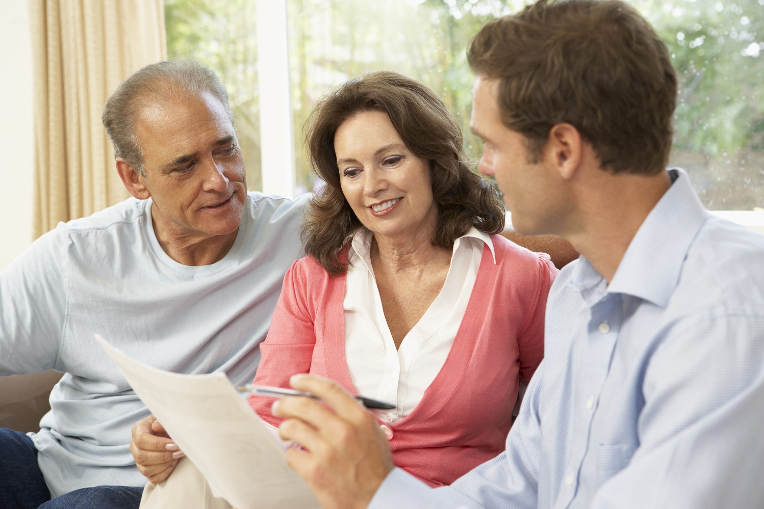 Three people looking over a long-term care insurance policy